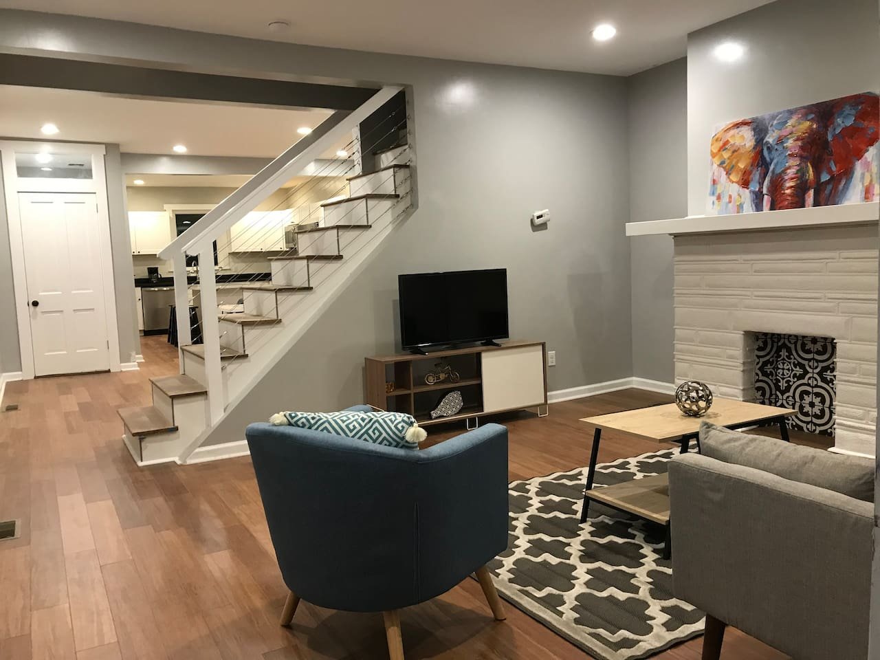 Trendy and comfy living room with access to dinning room and kitchen + Half Bathroom