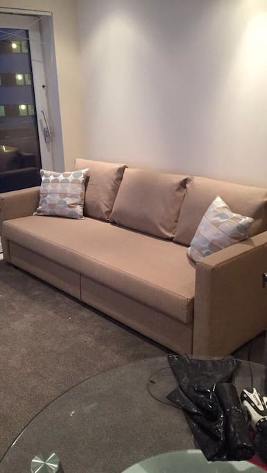 Comfortable sofa bed in living room