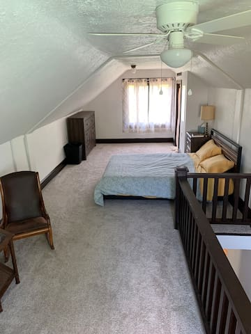 Master bedroom in the loft with comfy queen bed. Also has a half bath newly installed.