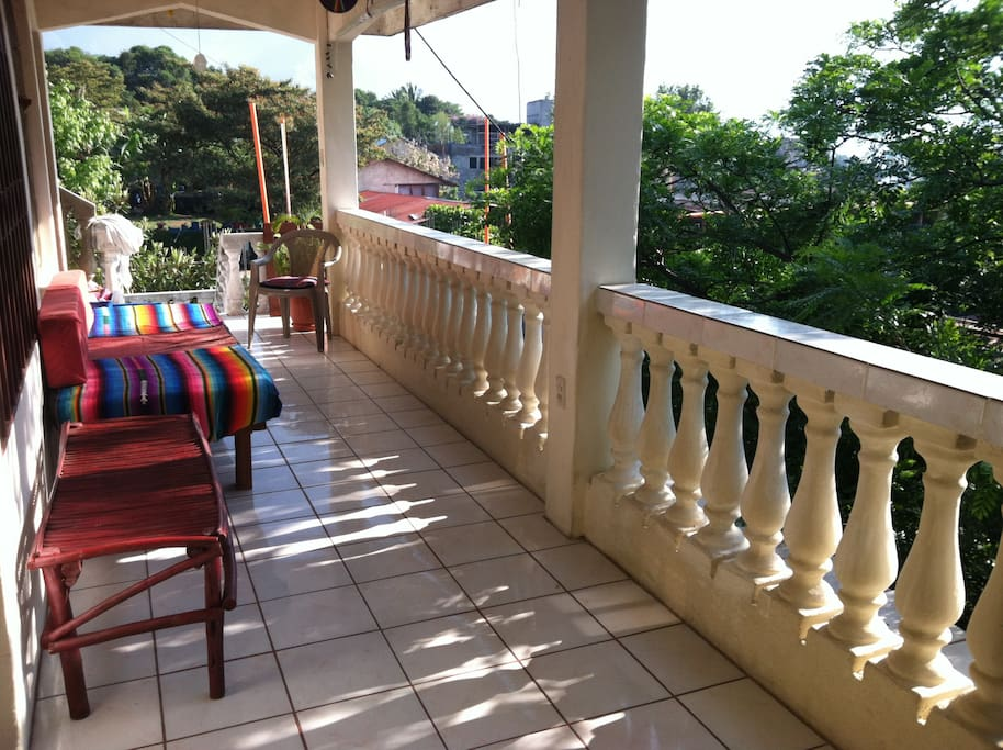 Covered veranda, perfect for relaxing and recounting the days activities.  You can even take a siesta on the daybed and fall asleep to the birds singing nearby.