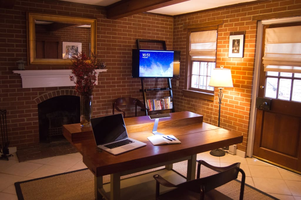 "Get some work done while you're here.  Hi-speed internet at your desk.  Enjoy the 40'"" flat screen display and sound bar.  Equipped with Apple TV loaded with apps."