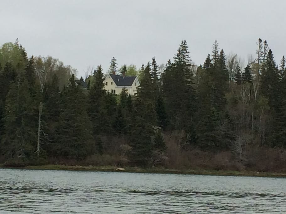 View of Yellow House from Cove, with unoccupied studio on left.