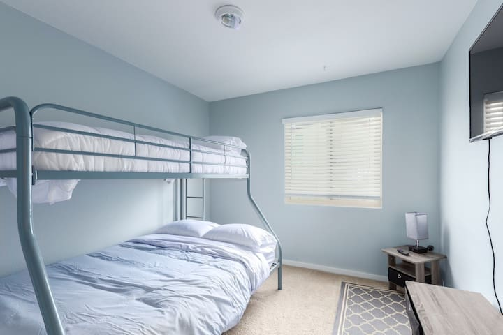 Bunk bed room with a full size mattress on bottom