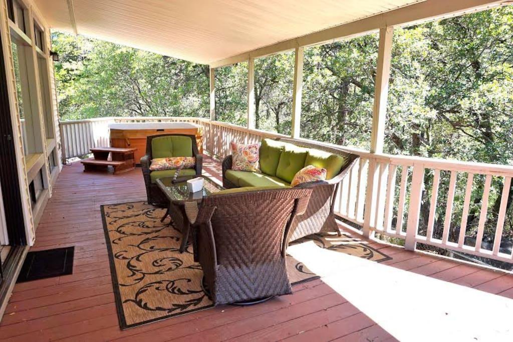 Back Deck with jacuzzi over looking creek