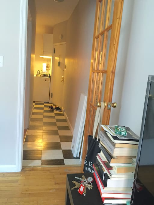 The main door leads into a hallway, one side end leading to the kitchenette and the other to the bedroom and lounge.