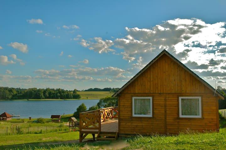Domek drewniany nad jeziorem - Stare Jabłonki - Skur