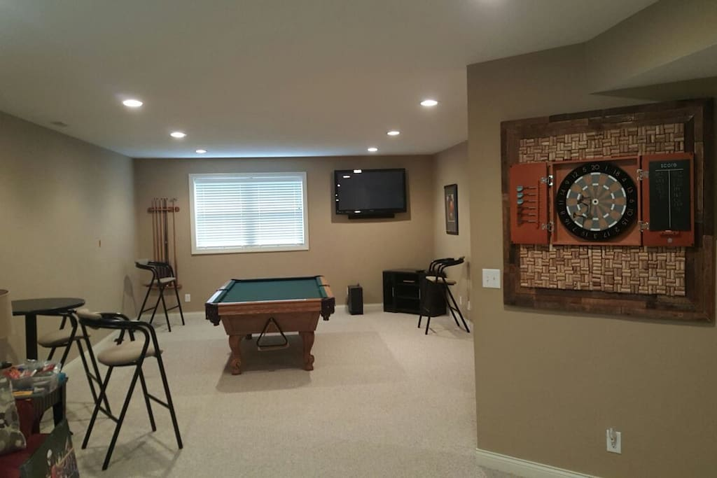 Pool, darts, and bar with flat screen wall mounted