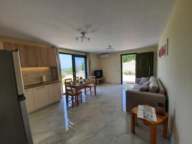 Spacious living room and fully equipped kitchen