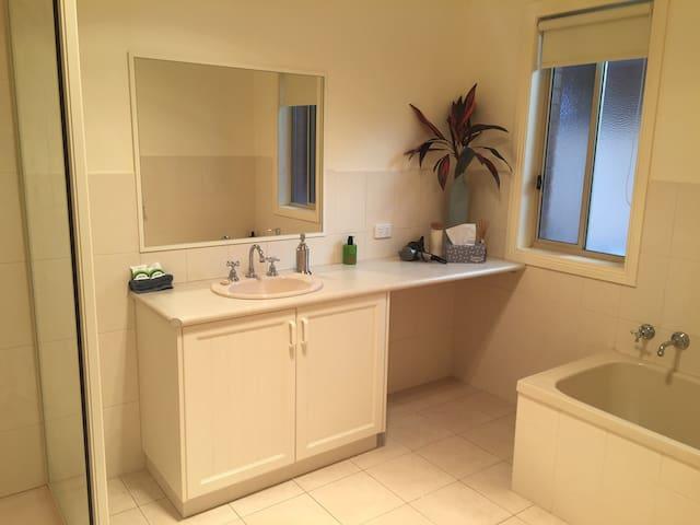 Large spacious bathroom .  Bath and shower.