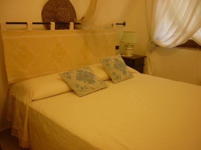 casetta confortevole e rilassante - Porto Palma - บ้าน