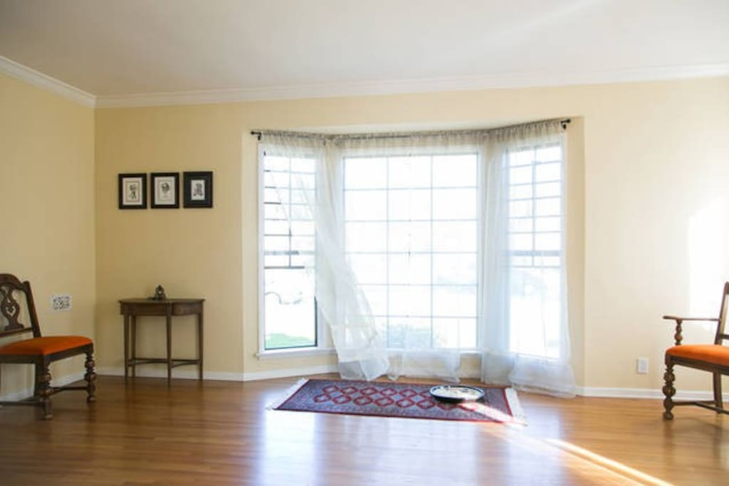 Living room with large bay window.