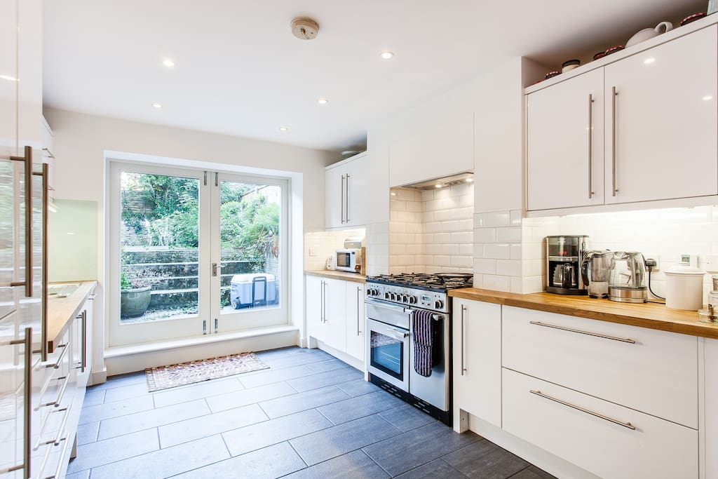 Bright, spacious kitchen with french doors to garden.