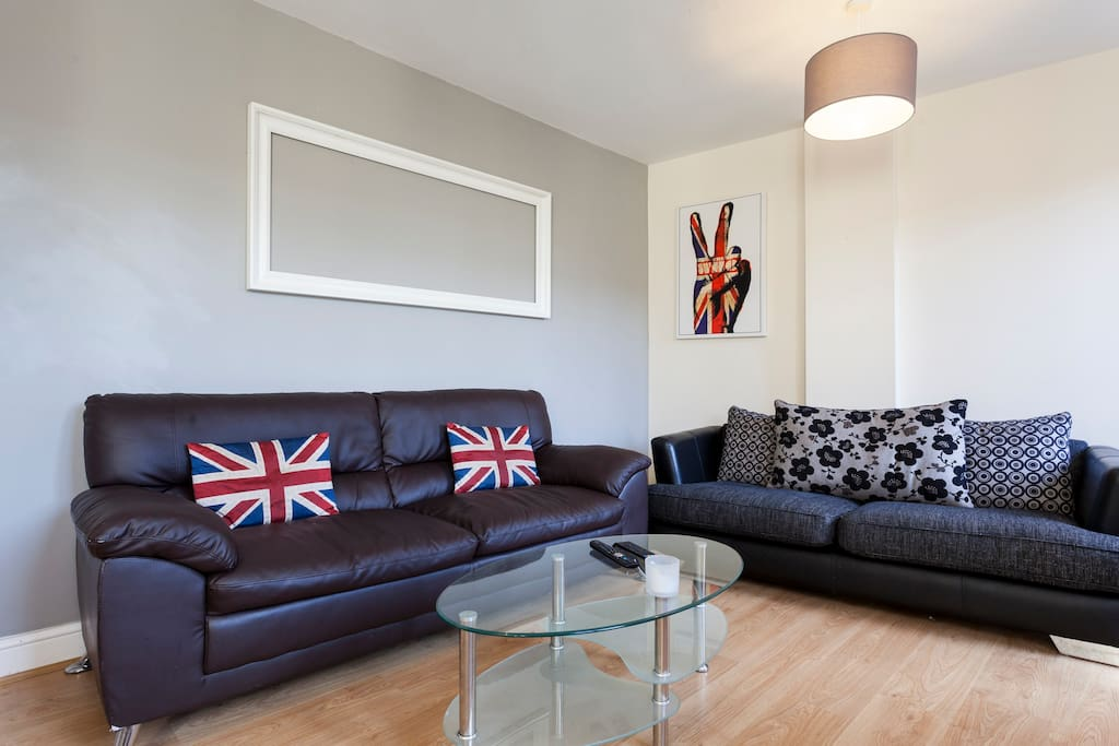 Big lounge with timber floor, leather sofas, recliner, TV, Apple TV and fibre optic broadband!
