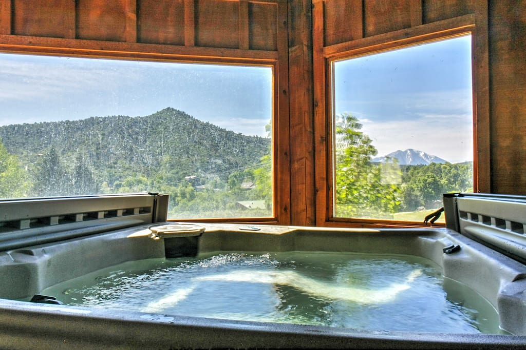 Soak your cares away in the home's private enclosed hot tub.