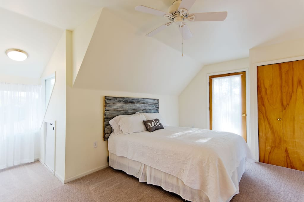 Bright and airy 3rd Floor Master Suite with private bathroom and deck with lake views