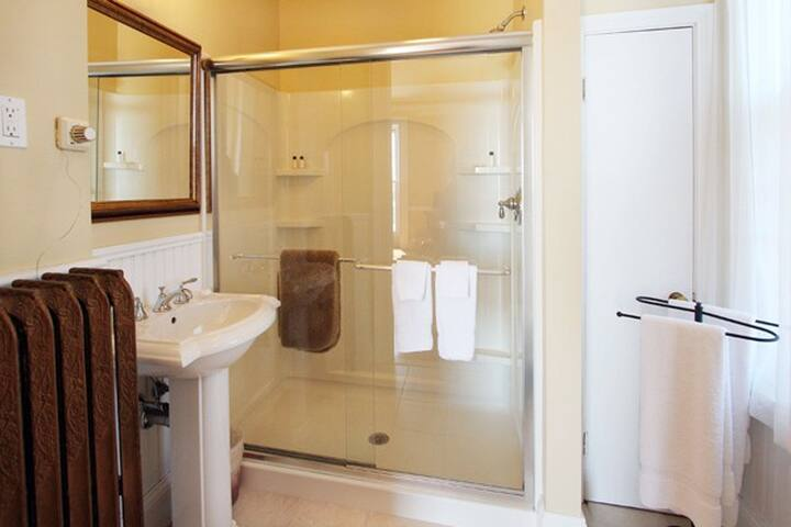 Private Walk-in shower, window.