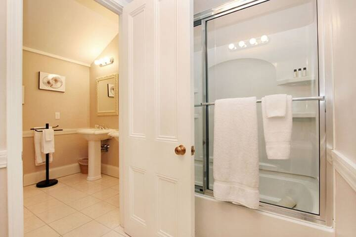 His & her sinks, tub and shower.