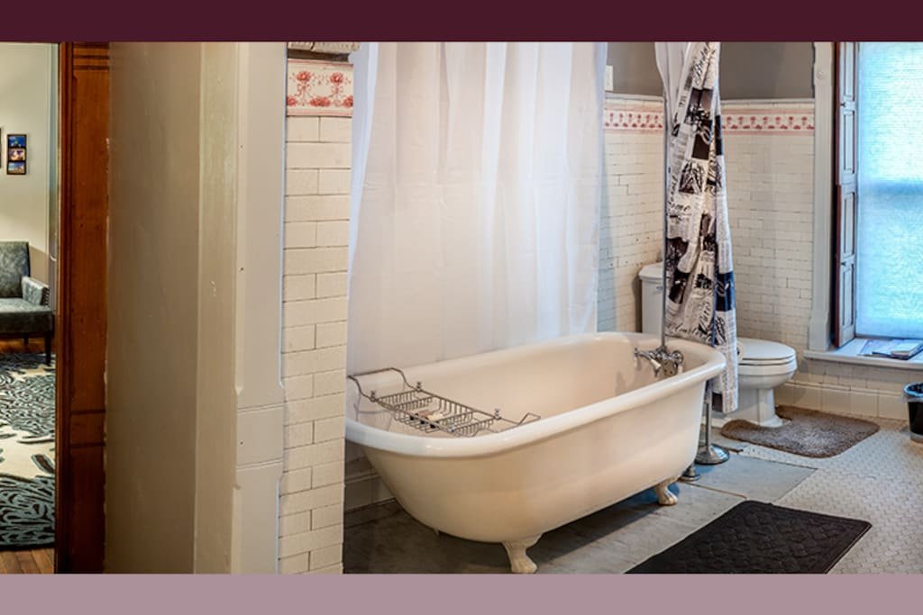 Original tile, claw foot tub/shower combo.