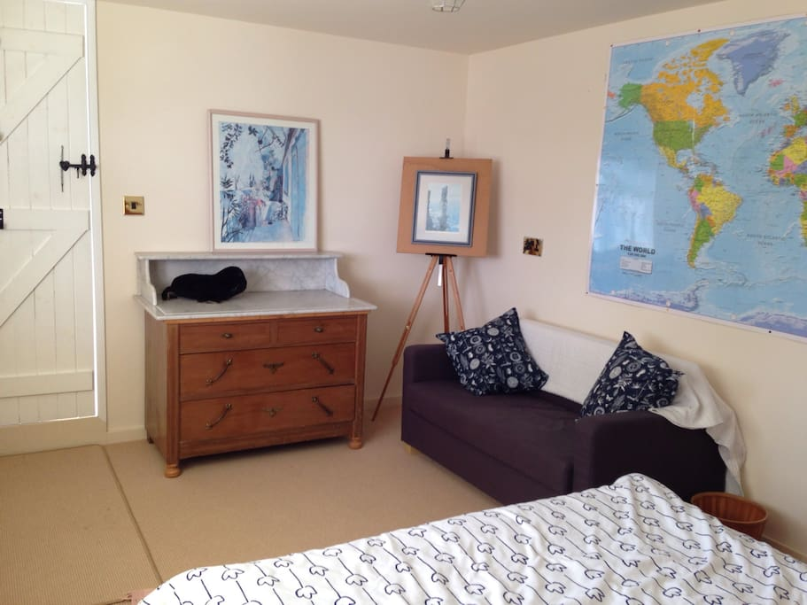 Spacious bedroom with real double bed and comfy sofa bed for extra guests