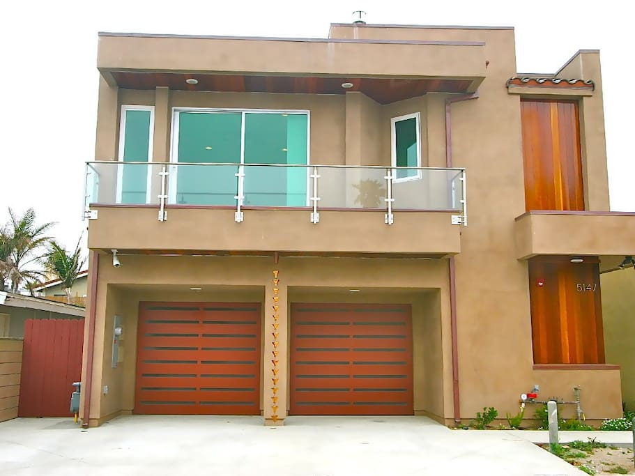 Front, garage, balcony by master bedroom.