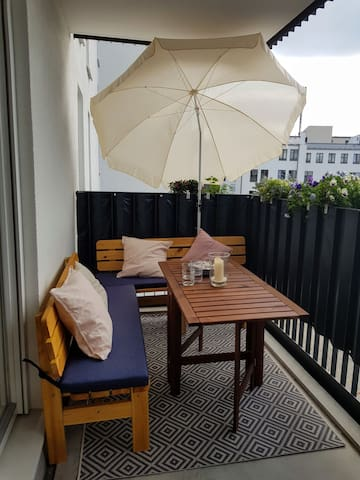 Balcony with BBQ and large seating area