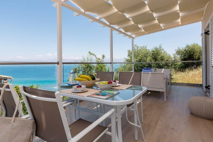 A newly built beach-front villa with stunning panoramic sea view