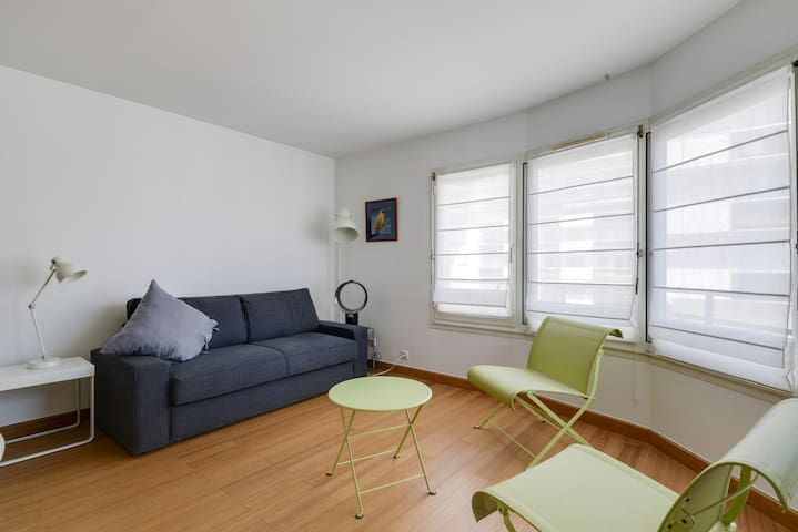Bright living room + sofa bed