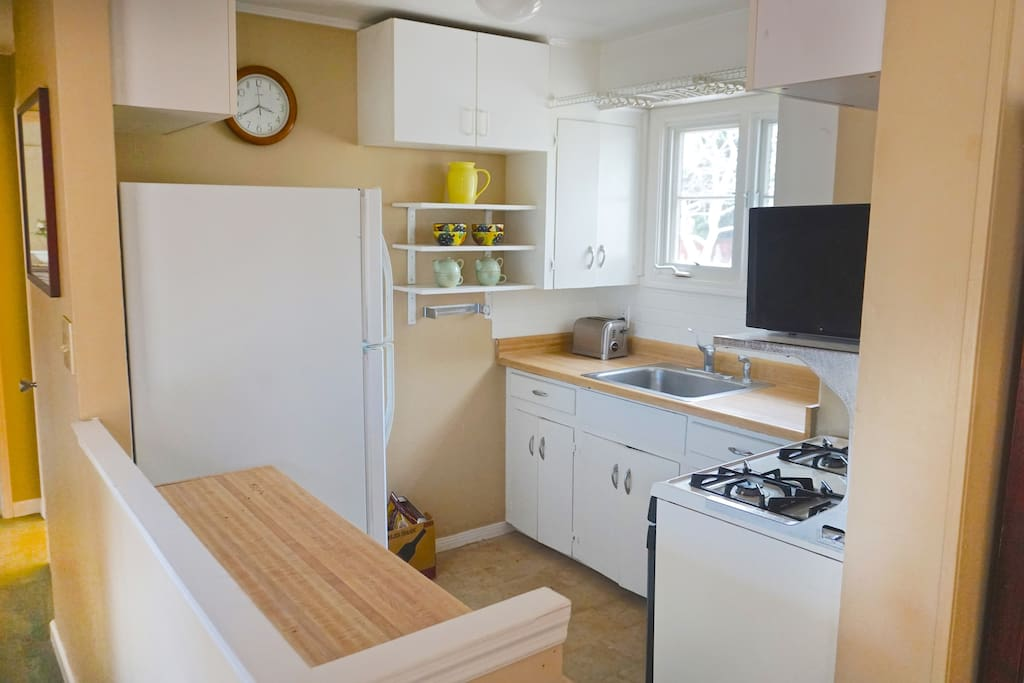 A real kitchen with gas stove and view of meadow garden