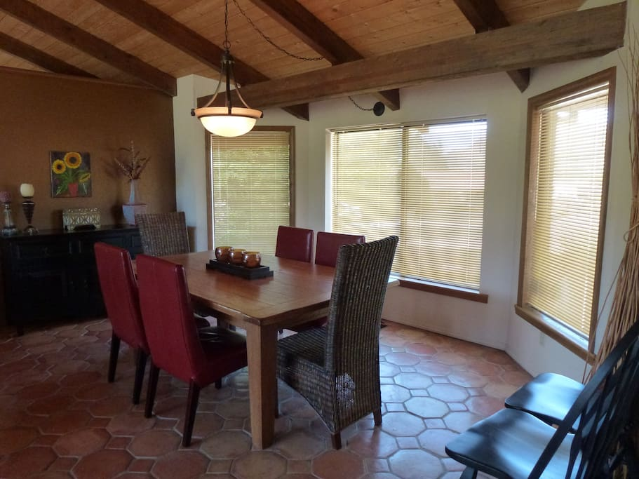 Dining Area with large table and six comfy chairs