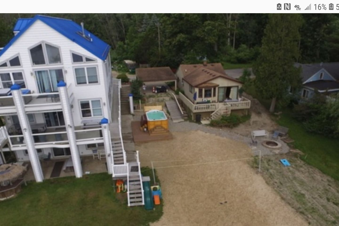 Waterfront Campau Heaven get both homes sleep 59-60 or in this listing the Lower level 15-18 of this 4 story 9  bedroom. Great location  you can jump on the boat or kayak after swimming in the heated swim spa 8 burner grills, volley ball pool table!