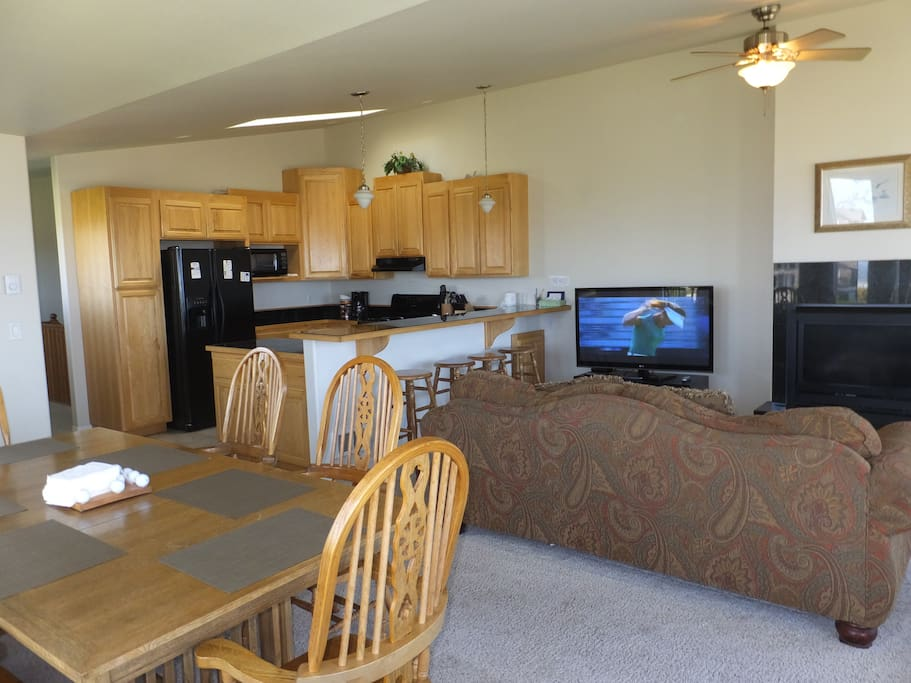 Great room with kitchen, dining, and living combined, all with great views