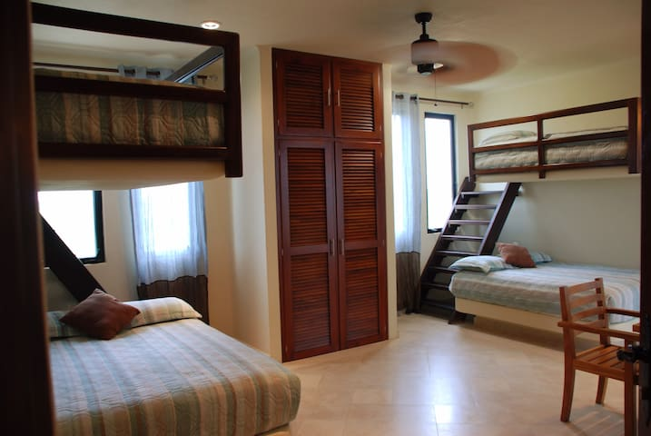 Upstairs monkey bedroom features 2 full & 2 twin sized beds with both jungle and oceanfront views. Located on second floor along with the two king size suites.