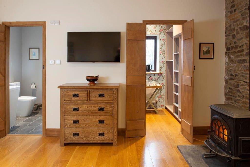 Your own en-suite shower, tv, dressing room and wood burner
