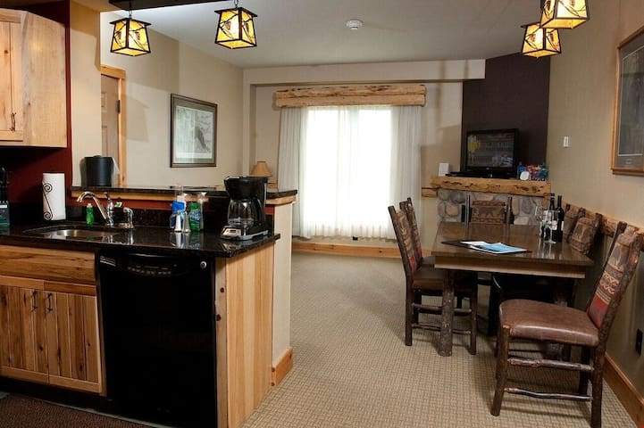 The beautiful open plan living area is great for enjoying meals with your group at the dining area