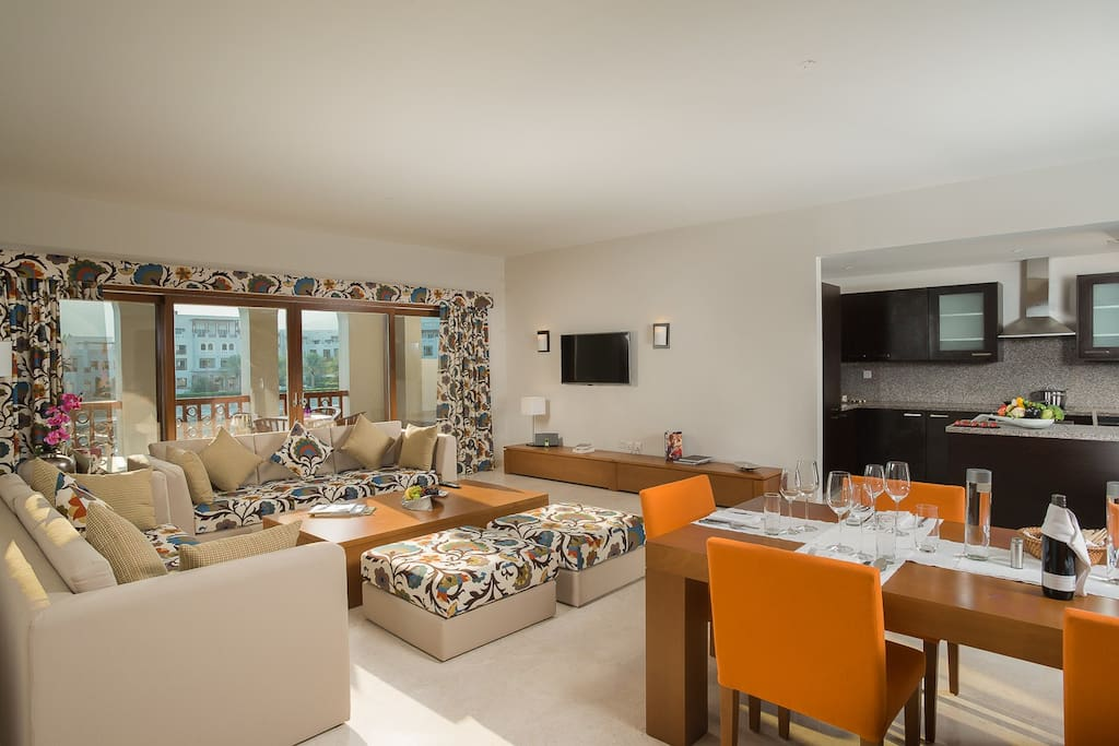 Large spacious living room with open plan kitchen. Flat screen tv with international channels. Balcony facing the Marina & ocean