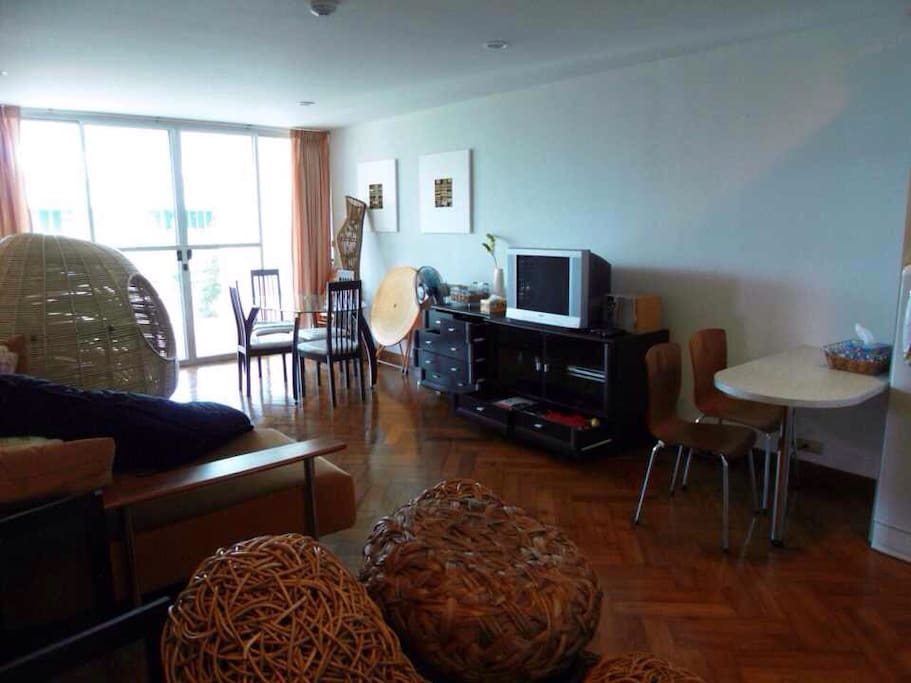 The living room is connected to the pantry and the balcony. There is a dvd player available.