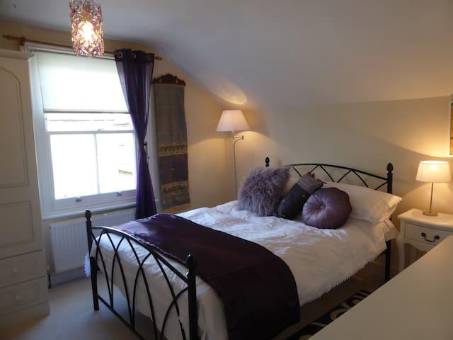 Luxury double bedroom with en-suite bathroom.
