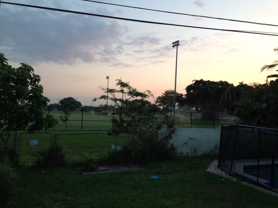 Local college soccer fields border the back of our property.