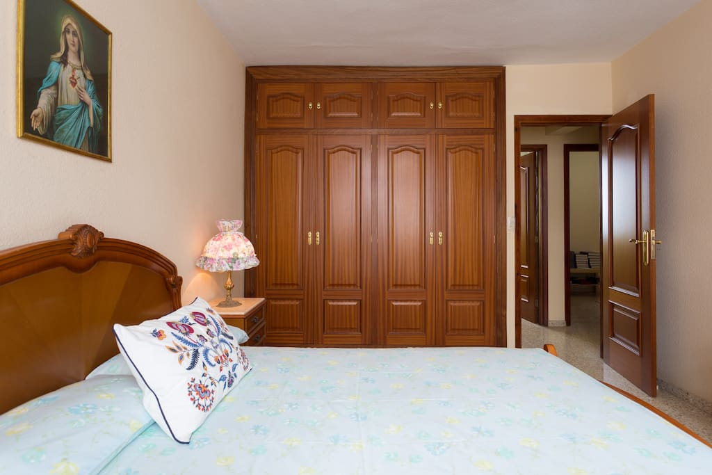 Closet and double bed.