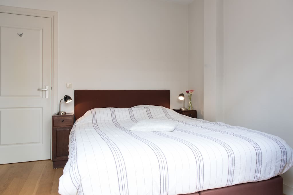 The bedroom with Queen double bed at the back of the house, quiet at night