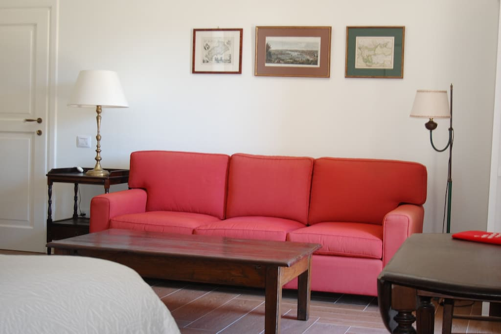 The sitting area of our guest bedroom offers you a relaxing area to enjoy a quiet moment.