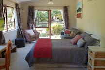 Studio set up with Queen bed only. Option to rearrange furniture to add up to two single beds.