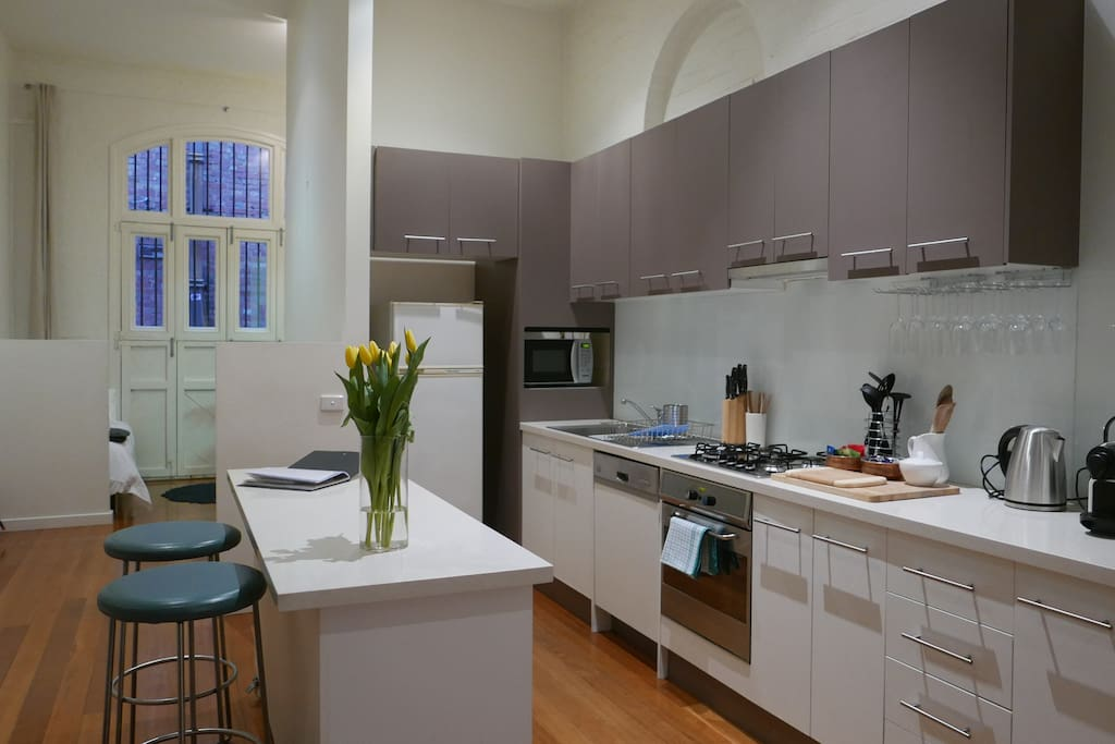 Well-appointed kitchen with gas cooking, kettle, stove, microwave, dishwasher, pots and pans, glassware, utensils and pantry containing olive oil, salt/pepper, teas, Nespresso coffee machine and capsules.