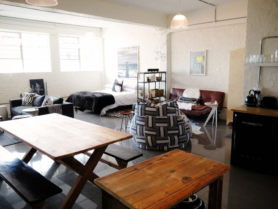 Loft space viewed from the kitchen area.