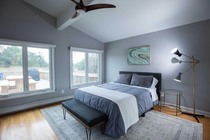 Deck Bedroom - Queen Note: bedroom has open ceiling