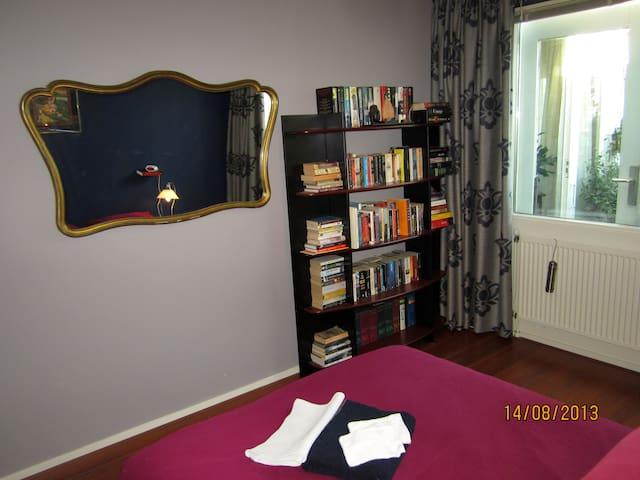 a pleasant & light bedroom