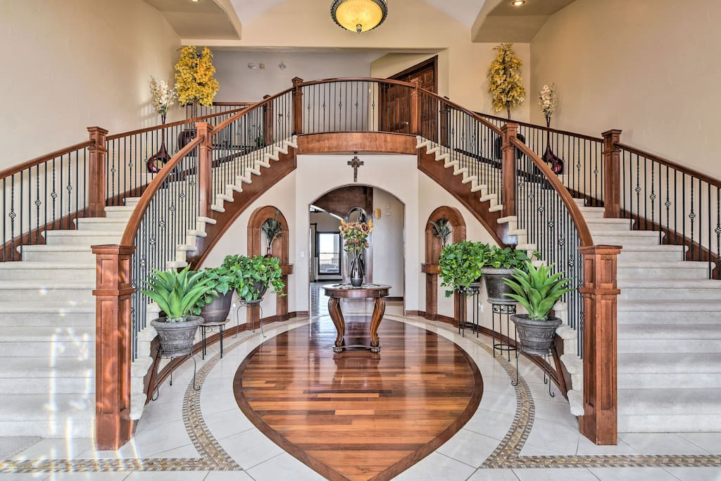 A large foyer lined with a dramatic double staircase and cathedral ceiling welcomes you inside and sets the tone for your lavish retreat!