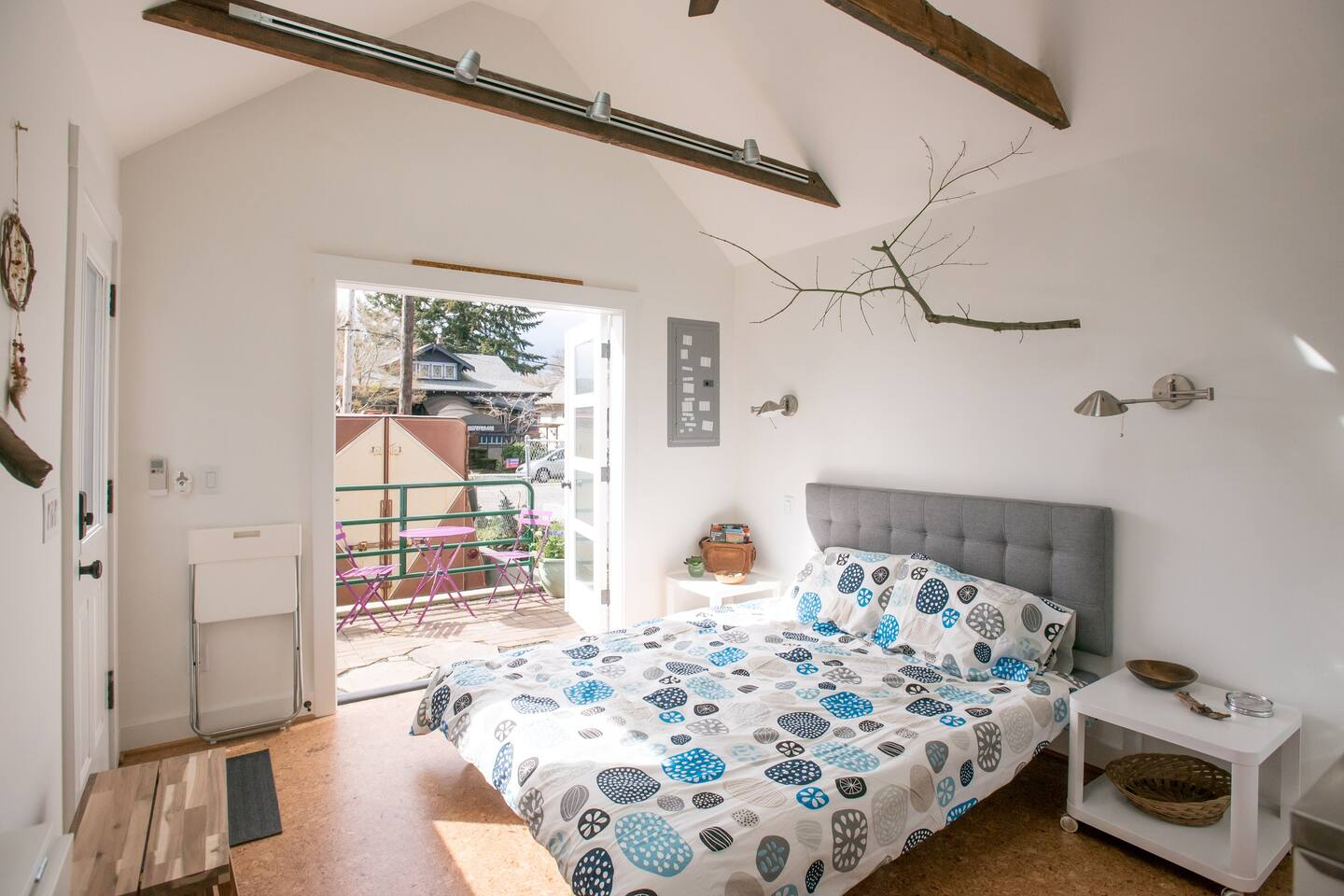 French doors open onto private patio. Tall ceiling with sky lights. Queen size bed.