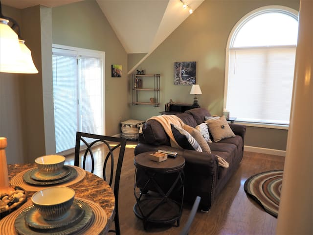 As you enter you will see our dining nook that opens up to the den.  Large windows and vaulted ceilings make this a great place to hang out and watch TV.  The couch also folds into a queen sleeper.