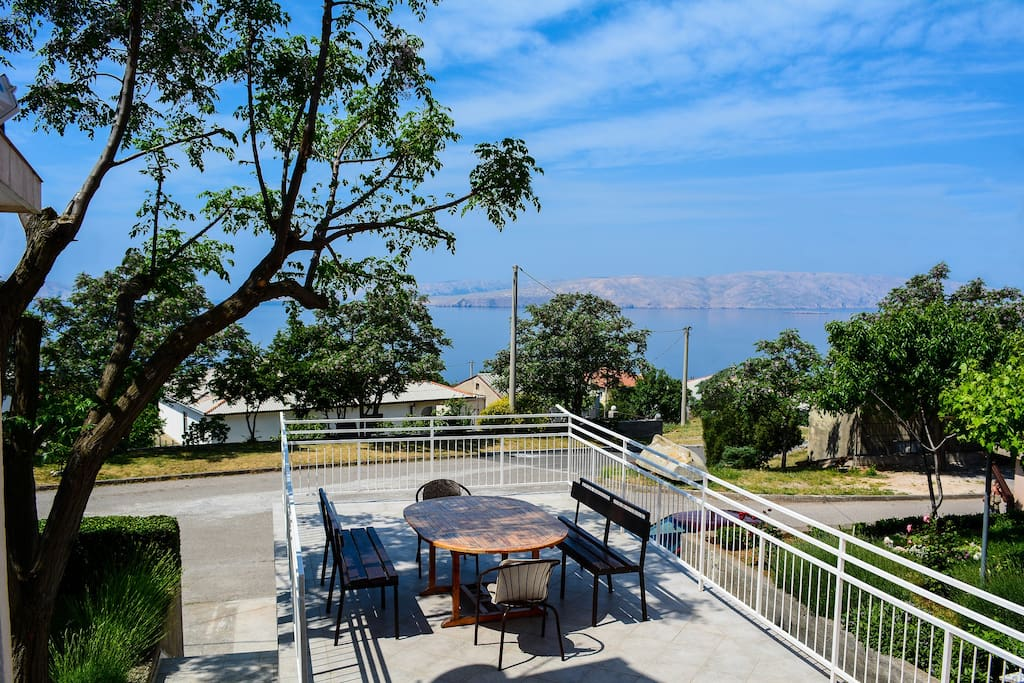 The most beautiful part of the apartment is the large teracce with and area of 50 square meteres with a beautiful view. A part of it is in the shade and there is a table with benches for 10 people.